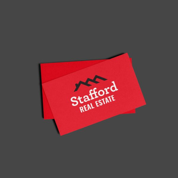 red business card with Stafford Real Estate logo